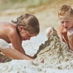 Sister-brother-building-Sand-Castle