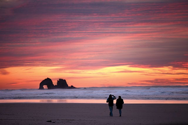 Couple strolling the beach, Rockaway Beach, Oregon