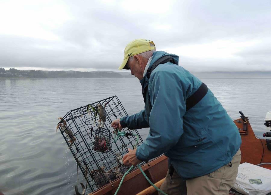 Man with a crab pot, Rockaway Beach, Oregon