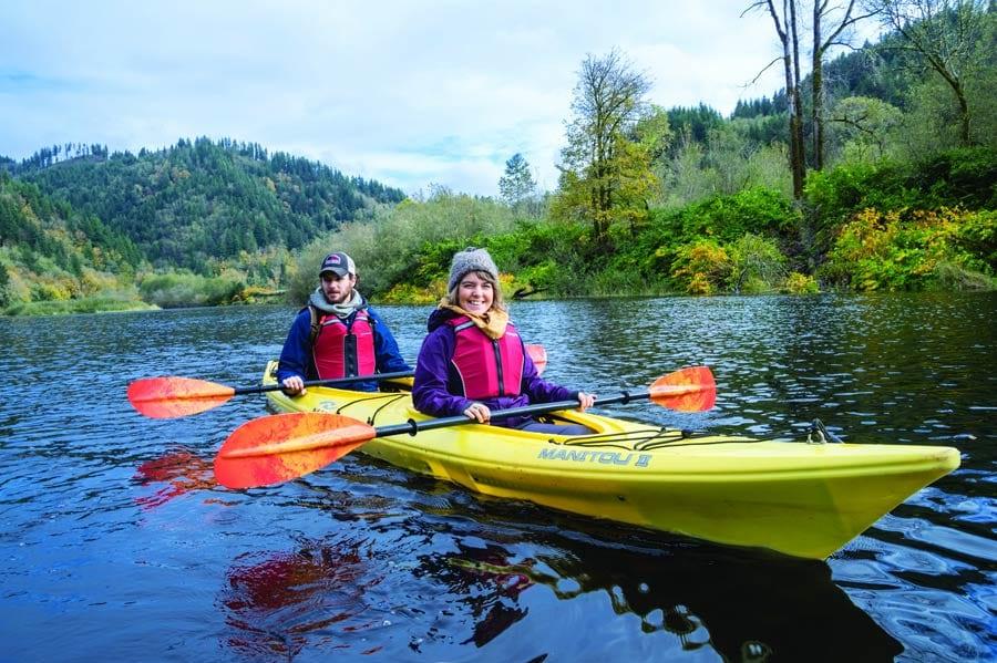 Couple kayaking, Rockaway Beach, Oregon