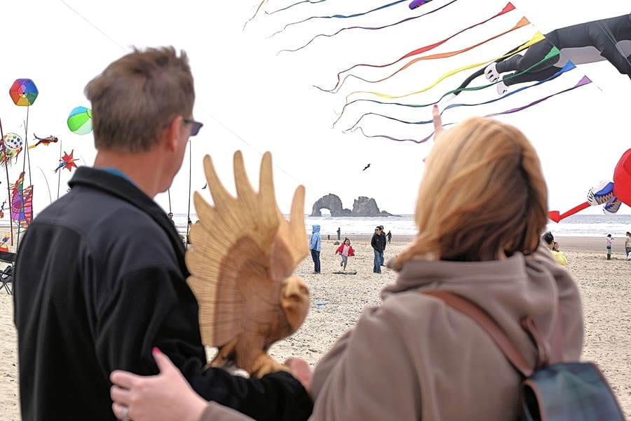 Couple flying kites, Rockaway Beach, Oregon